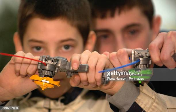 School friends Mark Phipps and James Avery both 14 and from Surrey try out BeyBlade battling spinning tops The customised spinning top are among the...