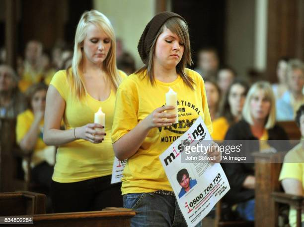 School friends of 14yearold Andrew Gosden carry candles to the alter of St James Church in Piccadilly central London during a service to mark the one...