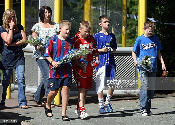 School friends of murdered 11 year old Rhys Jones lay flowers at the location of his shooting outside a bar in Liverpool northwest England 23 August...
