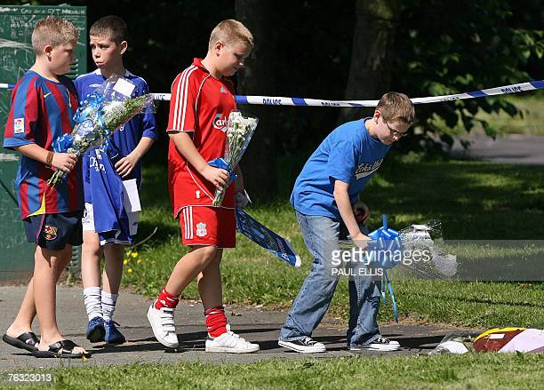 School friends of murdered 11 yearold Rhys Jones lay flowers at the location of his shooting outside a bar in Liverpool northwest England 23 August...
