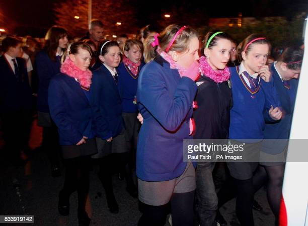 School friends of the children killed in the house fire in Omagh follow the vans carrying the family's seven bodies after they were removed from the...