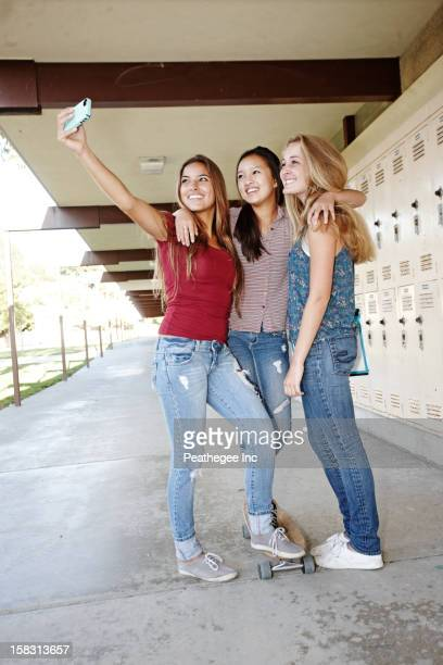 School friends taking self-portrait with cell phone