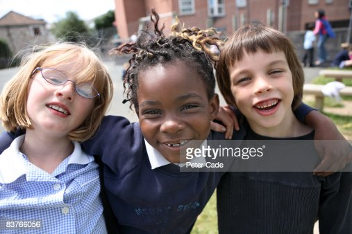school friends together in playground : Stock Photo