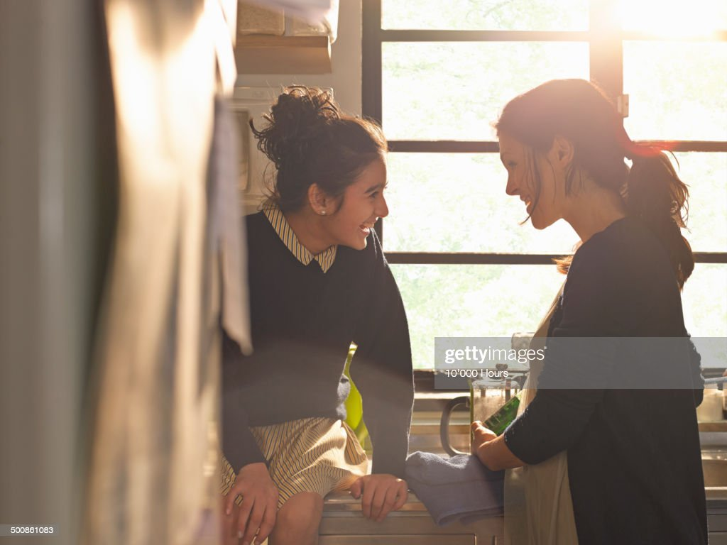 A school girl and her mother laughing together : Stock Photo