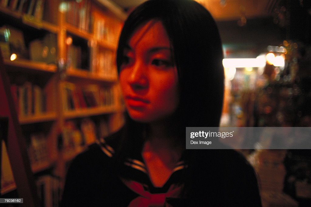 School girl at a shop : Stock Photo