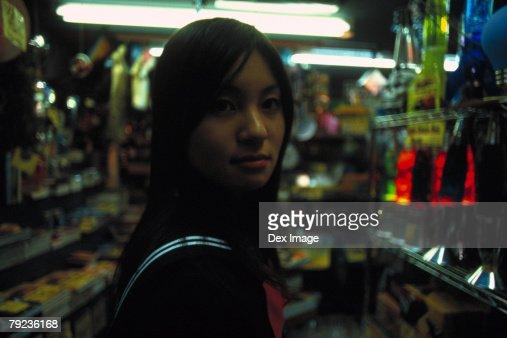 School girl at a shop : Stock Photo