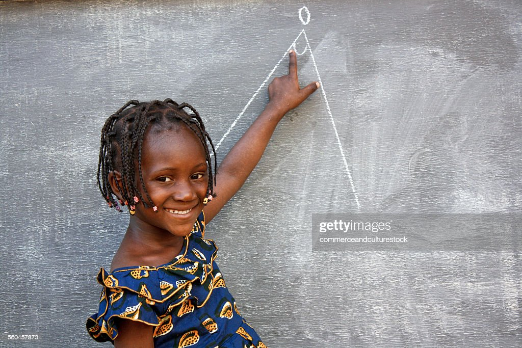 A school girl at the blackboard