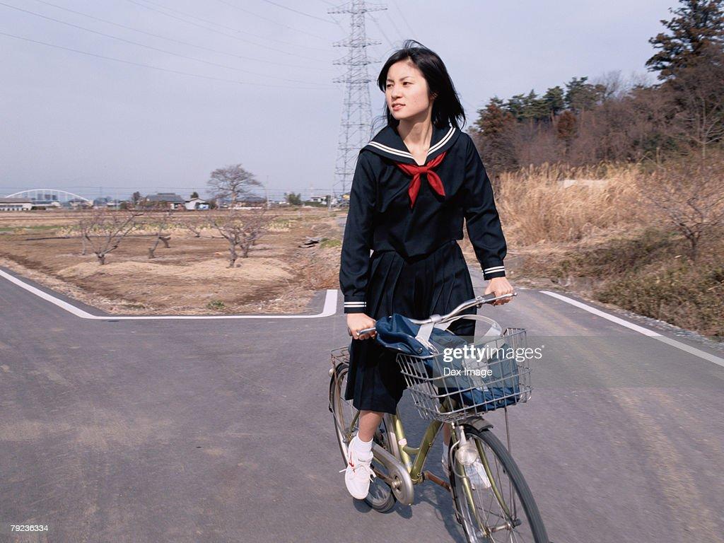 School girl cycling : Stock Photo