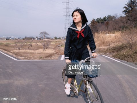 School girl cycling : Stock Photo