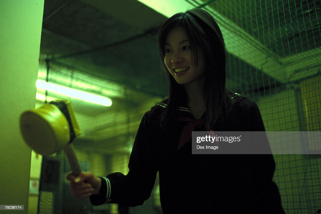 School girl holding a toy hammer : Stock Photo