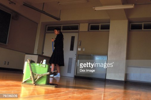 School girl mopping the floor : Stock Photo