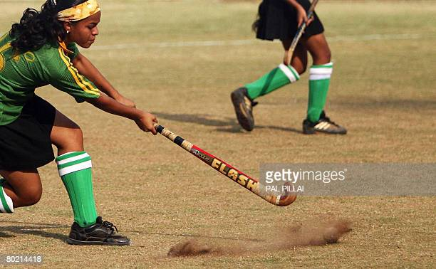 A school girl passes the ball during an under14 school hockey tournament in Mumbai on March 12 2008 In recent years India's national sport of hockey...