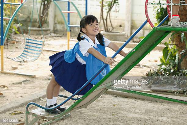 School girl playing in playground