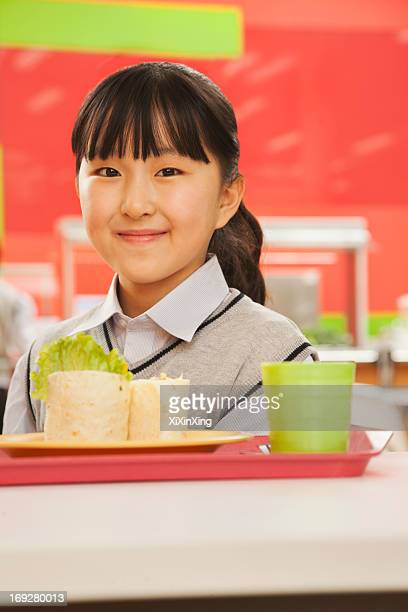 School girl portrait in school cafeteria