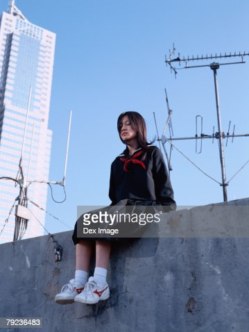 School girl  sitting on the roof top : Stock Photo