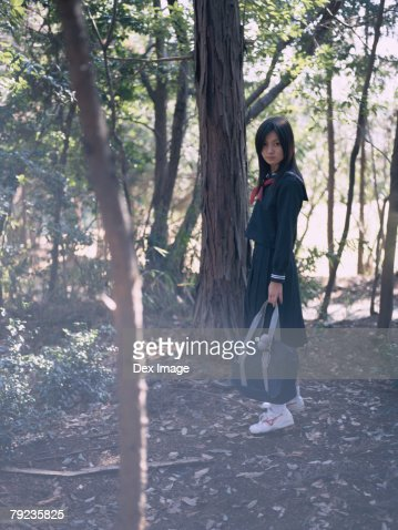 School girl standing in a park : Stock Photo