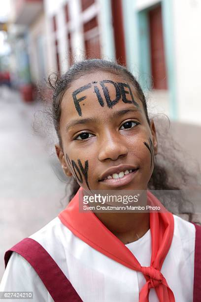 A school girl waits for the remains of former Cuban President Fidel Castro to pass by on their fourday journey across the country December 3 2016 in...
