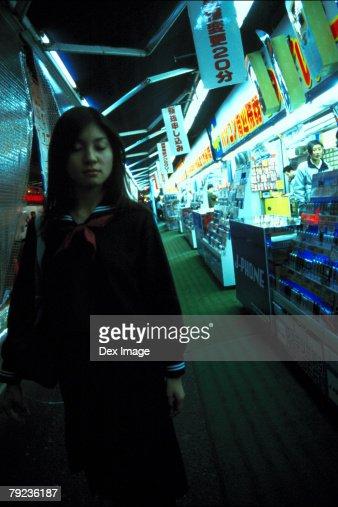 School girl walking along the street : Stock Photo
