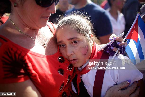 A school girl weeps after seeing the remains of former Cuban President Fidel Castro pass by on their fourday journey across the country December 3...