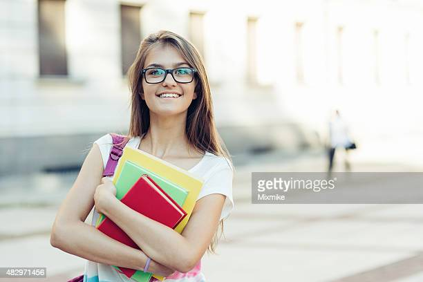 School girl with textbooks