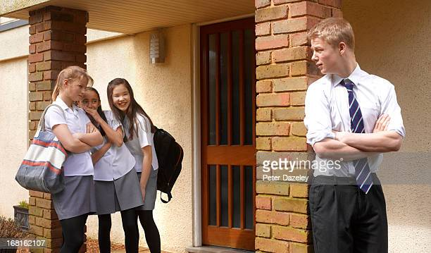 School girls bullying school boy
