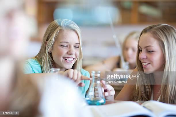 School girls enjoying science lesson