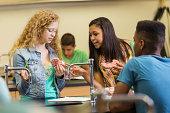 School girls examining brain model educational toy in science class