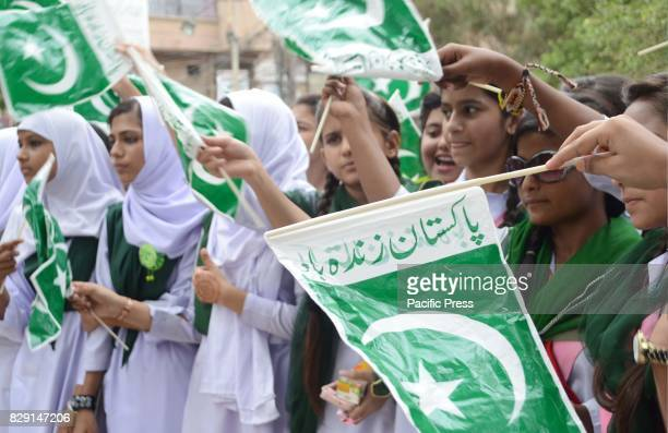 CLUB HYDERABAD SINDH PAKISTAN School girls holds Pakistani flags during the rally in connection of 70th Independence day of Pakistan out side...