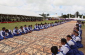 School girls line the pathway to the Royal Tomb during the State Funeral held for King George Tupou V at Mala'ekula on March 27 2012 in Nuku'alofa...