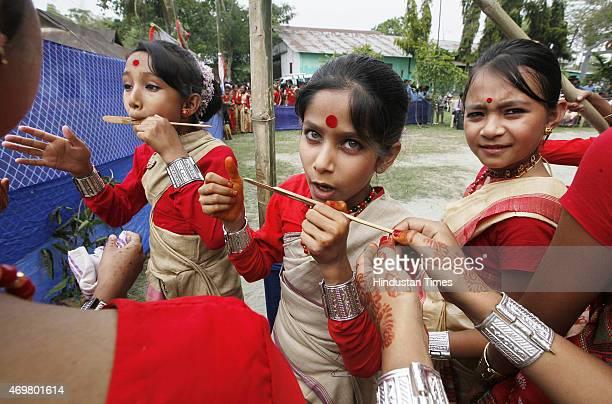 School girls playing Gogona a kind of musical instrument as they perform traditional Bihu dance on Assam Bihu Festival on April 14 2015 in Majuli...
