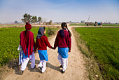 School girls return home for lunch after lessons