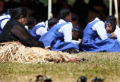 School girls taking part in the royal funeral struggle in the heat during the State Funeral held for King George Tupou V at Mala'ekula on March 27...