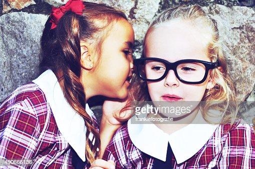 School girls telling secrets