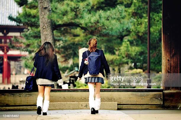 School girls walking on street