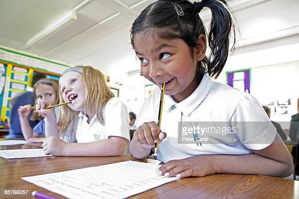 school girls writing in class