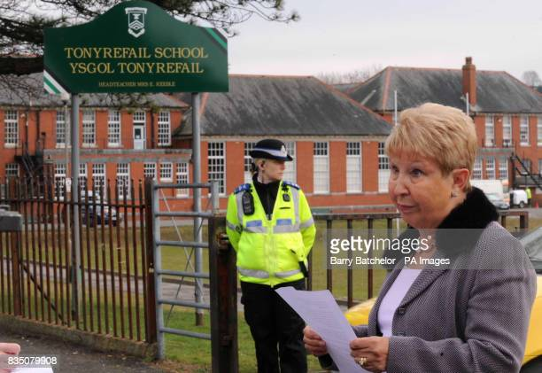 School Governor Eudine Hanagan reads a statement at the school gates of Tonyrefail Comprehensive School following the deaths of pupils Nikkita Marie...