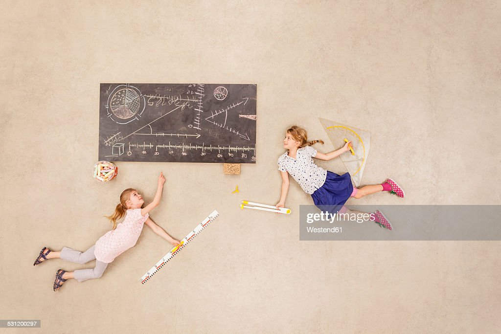 School kids calculating on blackboard