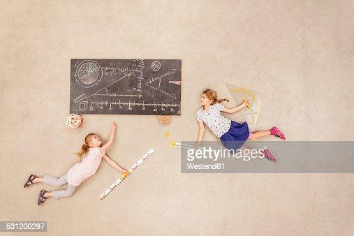 School kids calculating on blackboard