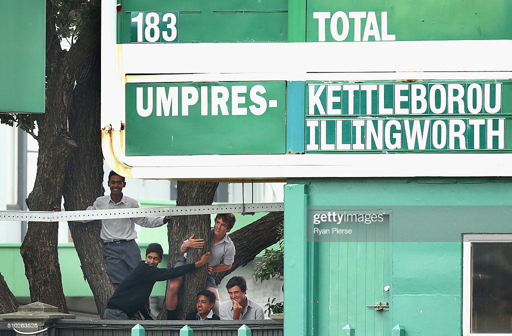 School kids climb a tree to see into the ground during day four of the Test match between New Zealand and Australia at Basin Reserve on February 15, 2016 in Wellington, New Zealand.