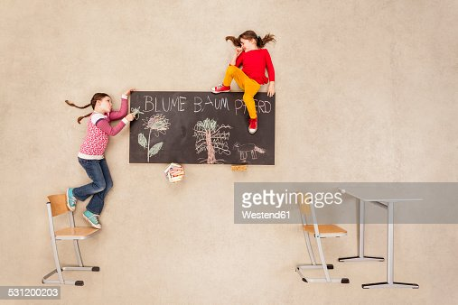 School kids drawing on blackboard