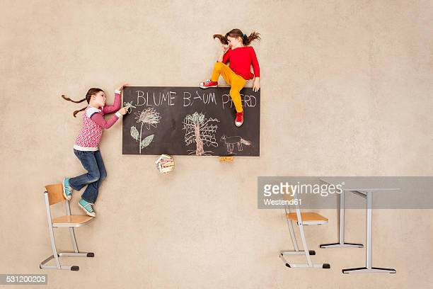 School kids drawing on blackboard