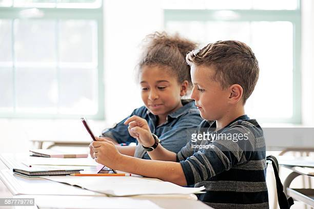 School kids in class using a digital tablet