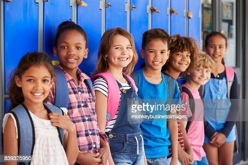 School kids in front of lockers in elementary school hallway : Stock Photo