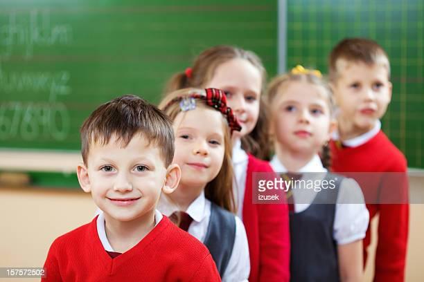 School Kids Standing In A Row, Classroom