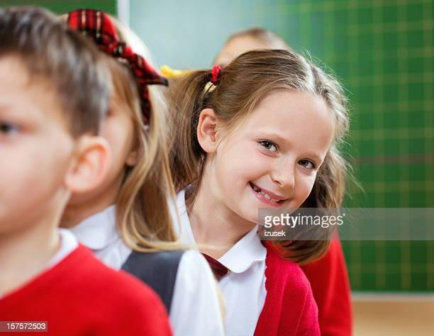 School Kids Standing In A Row, Girl Peeking Out