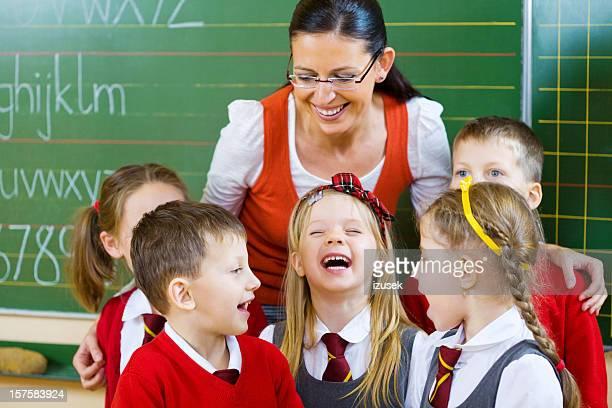 School Kids Standing With Their Teacher Singing, Portrait