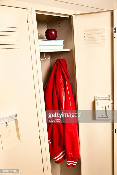 School locker with jacket, books and apple