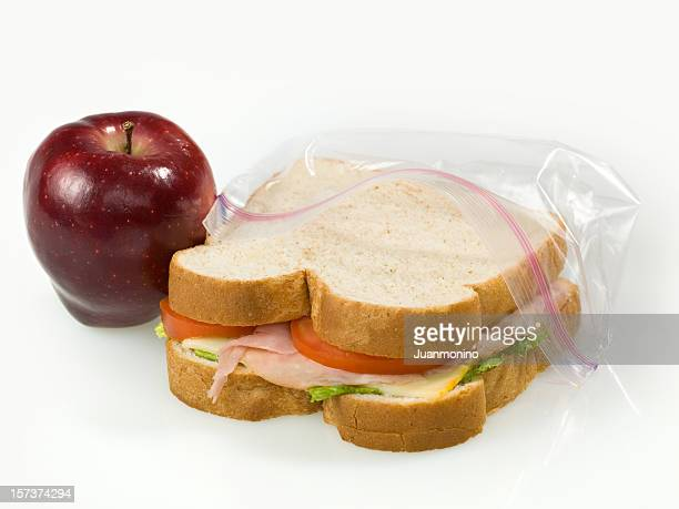 A School Lunch of an Apple and Sandwich