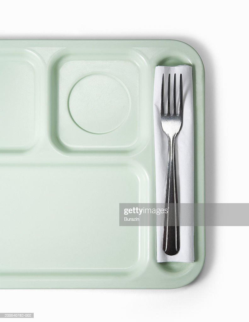 School lunch tray with fork, against white background, overhead view
