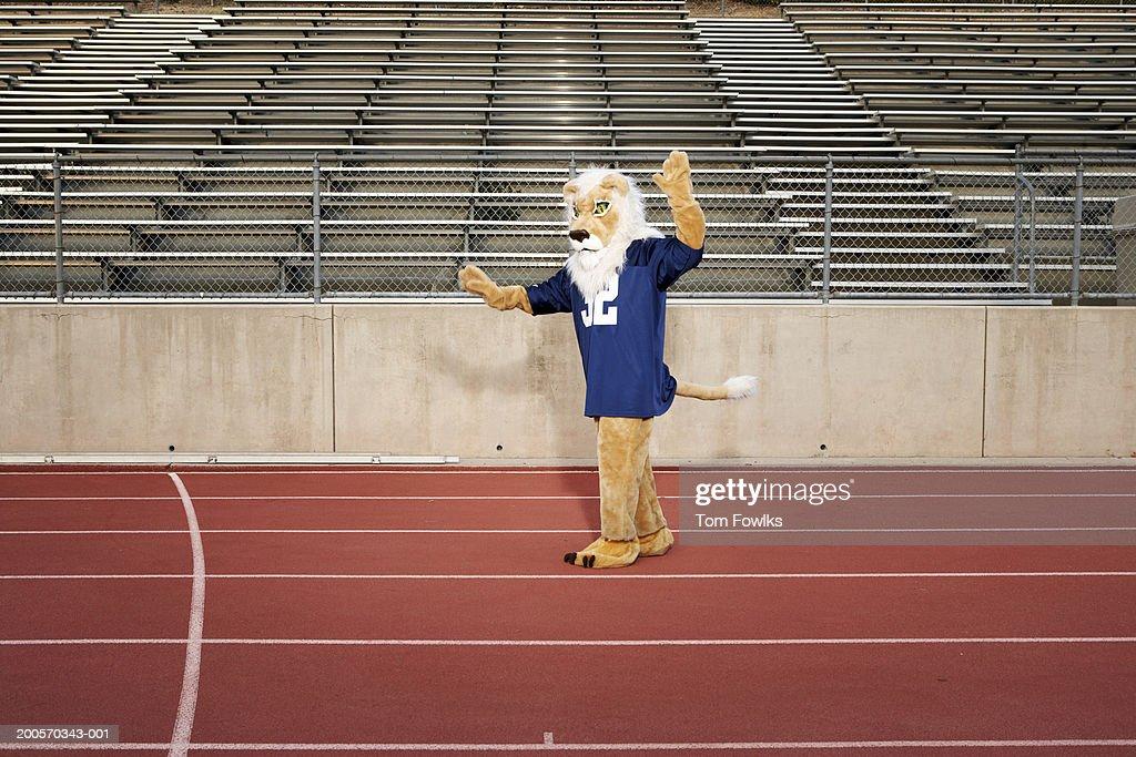 School mascot on running track : Stock Photo